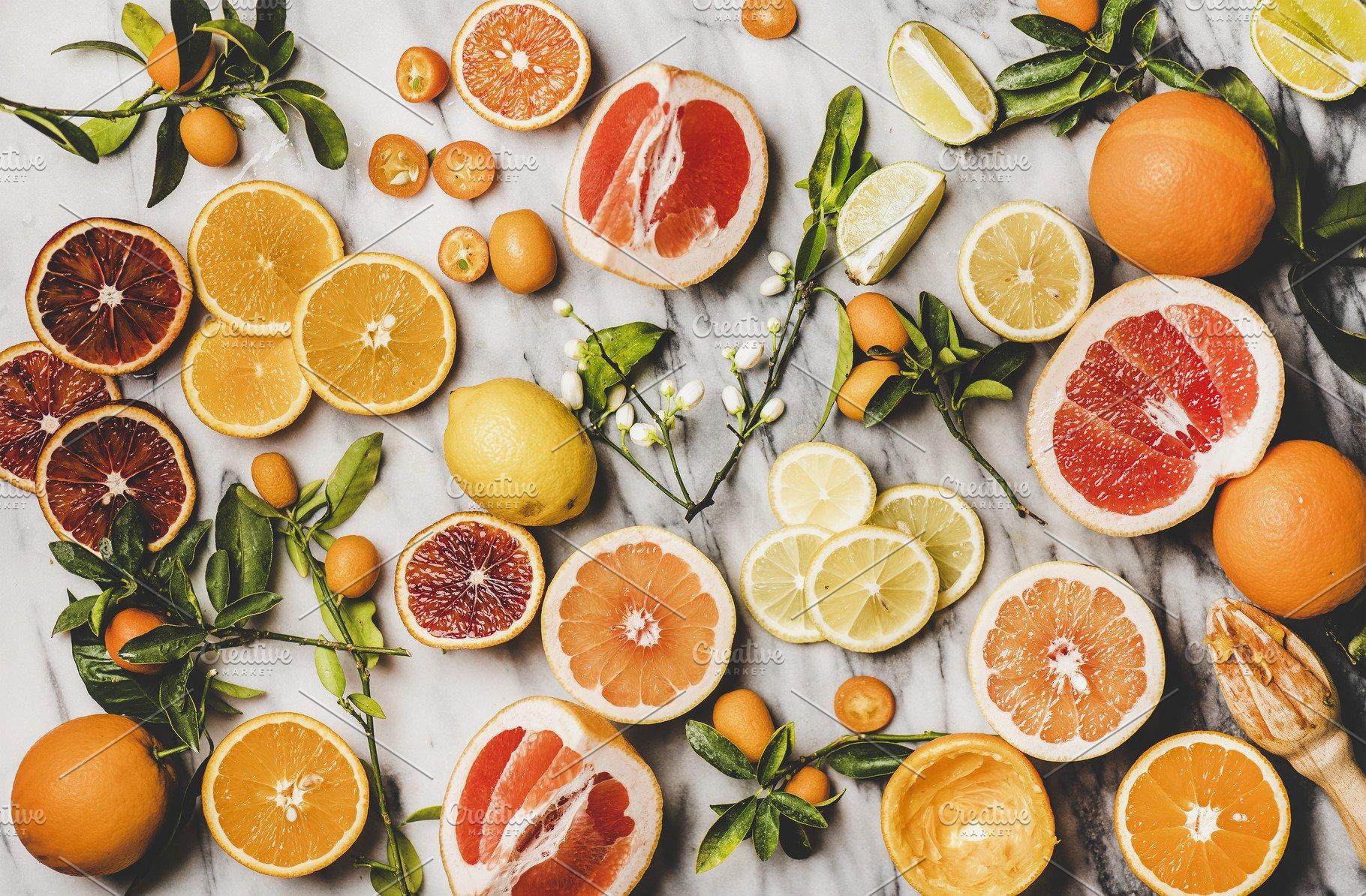 Flat-lay of fresh oranges, lemons