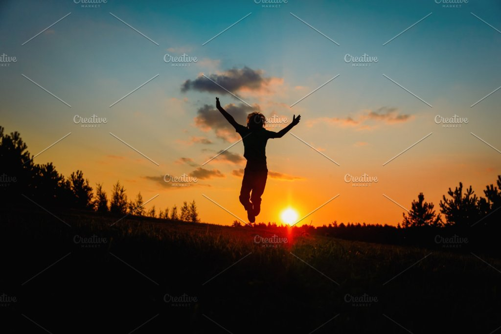 happy boy at sunset