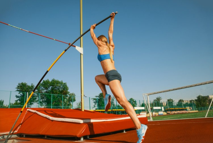Female high jumper training at the stadium